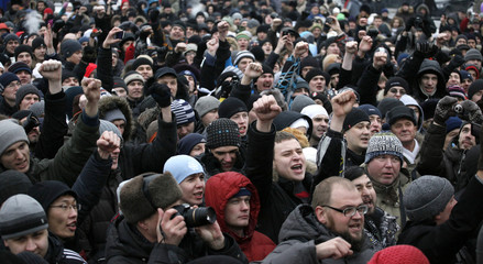 People hold a rally to protest against violations at the parliamentary elections in Krasnoyarsk