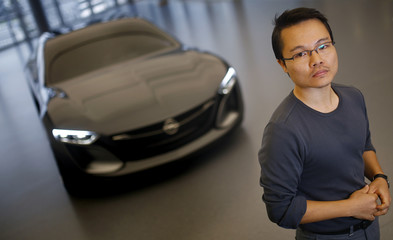 Kim, a South Korean designer for German car manufacturer Opel, poses for a photo in front of the Monza concept sports car at Opel's headquarters in Ruesselsheim