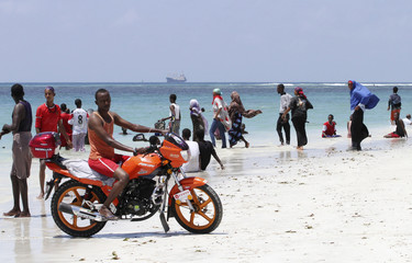 A man rides his motorbike at the Lido beach, near the waters of the Indian Ocean, north of Somalia's capital Mogadishu