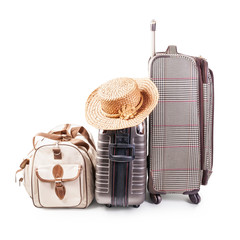 Suitcase and summer hat
