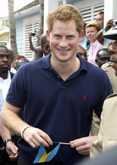 Britain's Prince Harry smiles during a tour of Harbour Island in Nassau
