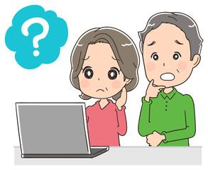 パソコンを使うシニア夫婦のイラスト