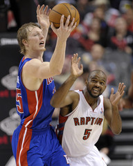 Detroit Pistons Sinclair grabs loose ball in front of Toronto Raptors Lucas III during NBA basketball game in Toronto