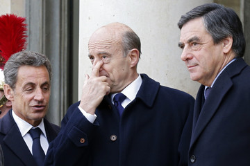 Former French president and current UMP conservative political party head Nicolas Sarkozy stands outside the Elysee Palace with former prime ministers Juppe and Fillon, in Paris