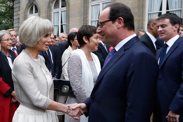 French President Hollande greets Elisabeth Guigou, French deputy and former minister, during a reception in honour of the French armed forces in Paris