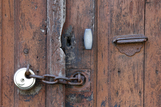 A lock and chain secures an access gate to a house in Goussainville-Vieux Pays, a ghost village, north of Paris
