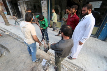 Residents dig and prepare a well amidst water shortages in a rebel-controlled area of Aleppo, Syria