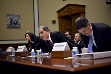 DEA administrator Leonhart, Justice Department Inspector General Horowitz and FBI Associate Deputy Director Perkins take their seats after being sworn in to testify before the House Committee on Oversight and Government Reform in Washington