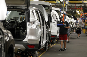 Louisville Assembly Plant employees work to assemble new 2013 Ford Escape on the production line at the company's newly transformed Louisville Assembly Plant in Louisville