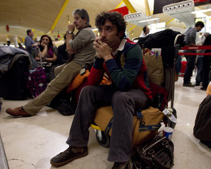 Stranded passengers wait in Madrid's Barajas airport after flights were cancelled due to an air traffic controllers walkout