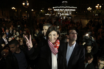 Anne Hidalgo, current Paris city deputy mayor and Socialist Party candidate in the mayoral election, give the Victory sign after winning in the second round in the French mayoral elections in Paris