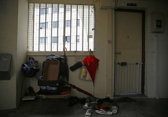 Shoes and belongings seen outside the apartment unit registered to Singaporean company Black Tidings, in Singapore