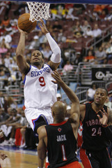 76ers Iguodala shoots under pressure from Raptors Jack and Weems during the fourth quarter of NBA basketball action in Philadelphia