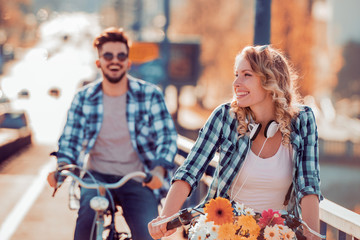 Couple riding on bicycles and having fun