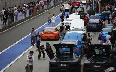 People attend the sport cars 2012 Super Show in Shanghai