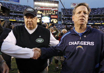New York Jets coach Ryan shakes hands with San Diego Chargers coach Turner after their NFL Divisional playoff football game in San Diego