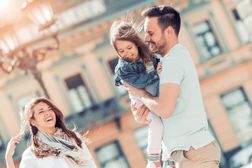 Happy young family in the city