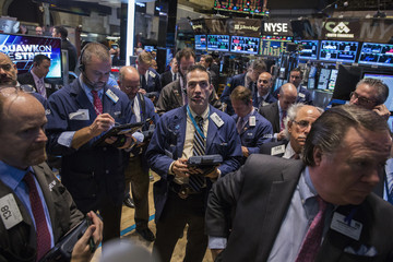 Traders work on the floor of the New York Stock Exchange shortly after the markets opened, in New York
