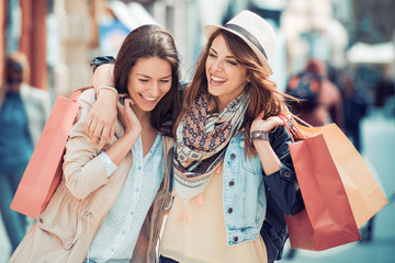 Happy friends shopping