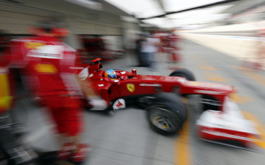 Ferrari Formula One driver Alonso drives out of his team garage during the third practice session of the Japanese F1 Grand Prix at the Suzuka circuit