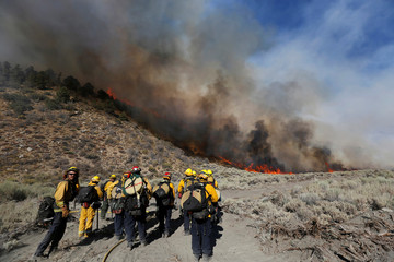 A hot shot crew waits while battling the Blue Cut fire near Wrightwood