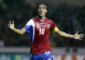 Ruiz of Costa Rica celebrates after scoring against Mexico during their 2014 World Cup qualifying match in San Jose