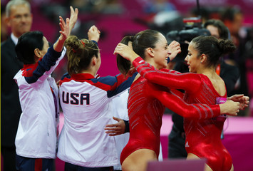 Alexandra Raisman of the U.S. hugs Jordyn Wieber after performing in the women's gymnastics team final in the North Greenwich Arena at the London 2012 Olympic Games