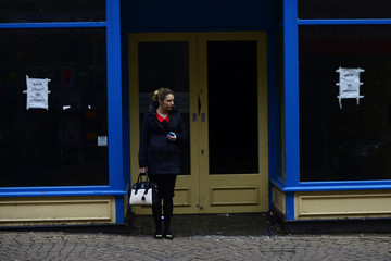 Woman stands at a doorway of a empty shop-front in the heart of Ramsgate