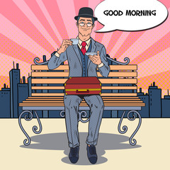 Pop Art Businessman Drinking Tea on the Morning in the City. Coffee Break. Vector illustration