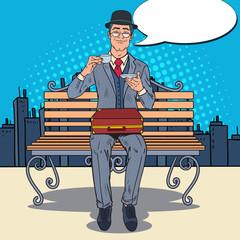 Pop Art Businessman Drinking Tea on the Bench in the City. Coffee Break. Vector illustration