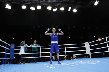 Ireland's Michael Conlan celebrates after being declared the winner over France's Nordine Oubaali following their Men's Fly (52kg) quarter-final boxing match at the London Olympic Games