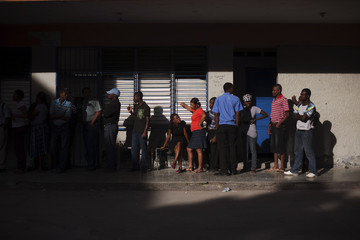 Voters line up to vote at Lycee National de Petionville in the Petionville neighborhood of Port-au-Prince