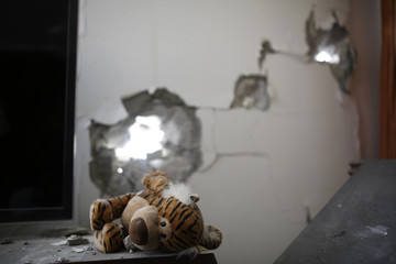 A stuffed toy lies at the scene after a rocket fired by Palestinian militants in Gaza landed in Ashdod
