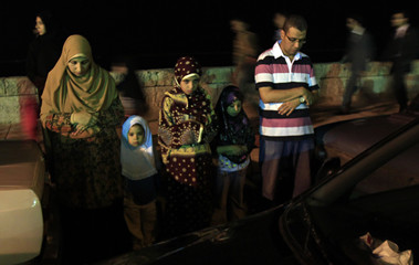 An Egyptian Muslim family performs evening prayers during Laylat al-Qadr in the holy month of Ramadan in Alexandria