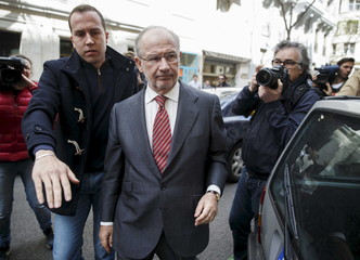 Former IMF chief Rodrigo Rato walks to the entrance of his office in Madrid