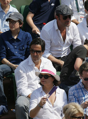 French actor and director Yvan Attal and actor Jean Dujardin watch the men's singles final match between Nadal of Spain and Djokovic of Serbia during the French Open Tennis tournament in Paris