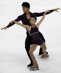 Takahashi and Tran of Japan compete in the the pairs free program during Cup of Russia figure skating competition in Moscow