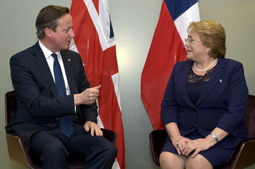 Britain's PM Cameron holds a bilateral meeting with Chile's President Bachelet during the EU-CELAC Latin America summit in Brussels, Belgium