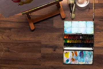 Artist workplace. Watercolor paint and brushes. Drawing lessons, art school, young painter concept