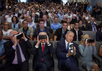 Rivlin, Peres and Netanyahu are seen with virtual reality goggles during a ceremony at the Peres Center for Peace in Jaffa
