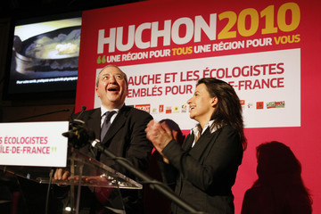 Jean-Paul Huchon, president of the Ile-de-France region and Socialist Party candidate winner, and Cecile Duflot, French Green party leader speak after second round win in Paris