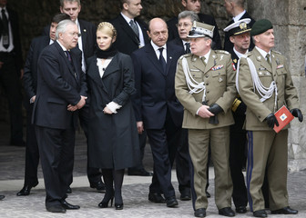 Ukraine's former Prime Minister Tymoshenko and Romania's President Basescu attend funeral procession for late Polish President Kaczynski and his wife Maria in Krakow