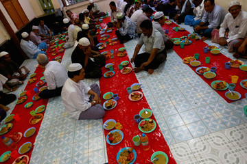 Muslims pray before iftar, or the breaking of fast meal, during the holy fasting month of Ramadan at a mosque in Yangon