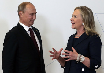 Russia's President Vladimir Putin meets U.S. Secretary of State Hillary Clinton upon her arrival at the Asia-Pacific Economic Cooperation (APEC) Summit in Vladivostok