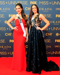 Miss Universe candidates Dajana Dzinic of Austria and Violina Ancheva of Bulgaria pose for a picture during a red carpet inside a SMX convention in metro Manila