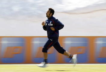 Italy's soccer player Cassani runs during their morning training session in Sestriere