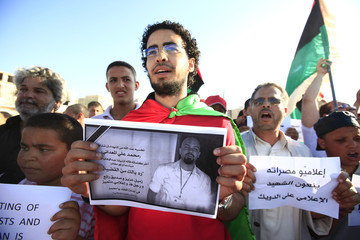A man holding a poster of Libyan journalist Ali Muhammed Al-Maadani takes part in a small demonstration in Tripoli street in central Misrata