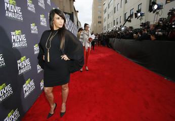 Kim Kardashian arrives at the 2013 MTV Movie Awards in Culver City, California