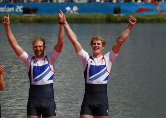 Bronze medallists George Nash and William Satch of Britain celebrate during the medals ceremony after winning the Men's Pair Final event during the London 2012 Olympic Games at Eton Dorney