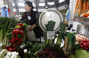 A vendor sells fresh herbs at the city market in St.Petersburg